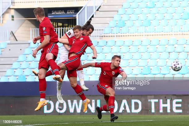 Caglar Soyuncu of Turkey scores their team's second goal during the FIFA World Cup 2022 Qatar qualifying match between Norway and Turkey at the La...
