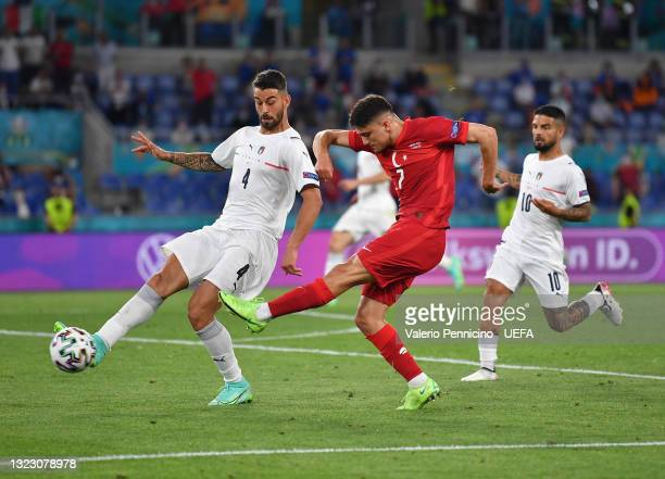 Caglar Soyuncu of Turkey shoots whilst under pressure from Leonardo Spinazzola of Italy during the UEFA Euro 2020 Championship Group A match between...