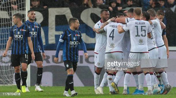 Cagliari Calcio players celebrate the opening goal during the Serie A match between Atalanta BC and Cagliari Calcio at Gewiss Stadium on November 3...