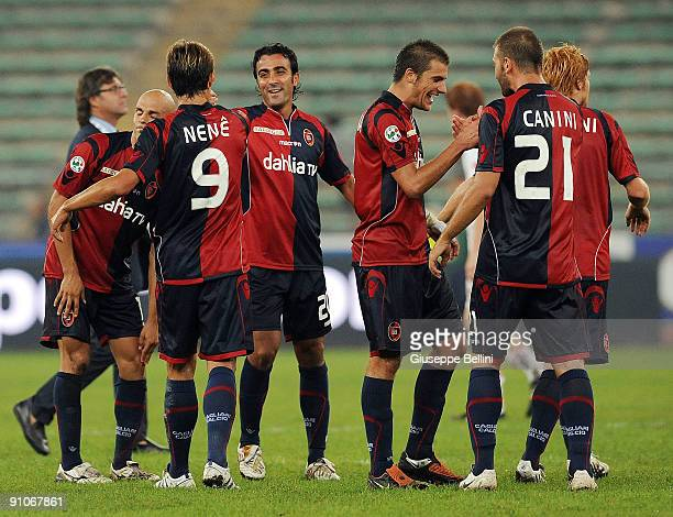Cagliari Calcio players celebrate victory after the Serie A match between Bari and Cagliari at Stadio San Nicola on September 23, 2009 in Bari, Italy.