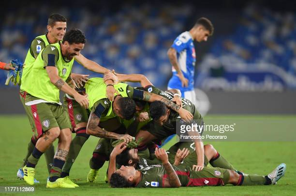 Cagliari Calcio players celebrates the 01 goal scored by Lucas Castro beside the disappointment of Giovanni Di Lorenzo of SSC Napoli during the Serie...