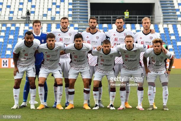 Cagliari Calcio team line up ahead of the Serie A match between US Sassuolo and Cagliari Calcio at Mapei Stadium Città del Tricolore on September 20...