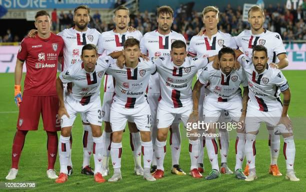 Cagliari Calcio team line up prior to the serie A match between Atalanta BC and Cagliari at Stadio Atleti Azzurri d'Italia on September 2 2018 in...