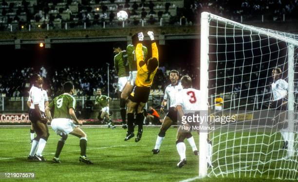 Cagliari , Italy - 11 June 1990; England goalkeeper Peter Shilton clears under pressure from Paul McGrath and Niall Quinn of Republic of Ireland...