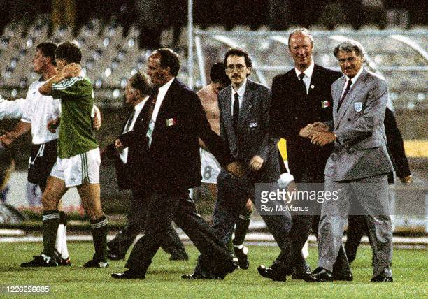 Cagliari Italy 11 June 1990 England manager Bobby Robson right shakes hands with Republic of Ireland manager Jack Charlton following the FIFA World...