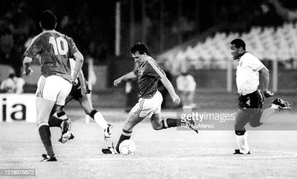 Cagliari , Italy - 11 June 1990; Ray Houghton of Republic of Ireland in action against John Barnes during the FIFA World Cup 1990 Group F match...