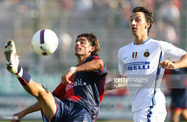 Inter Milan Zlatan Ibrahimovic of Sweden fights for the ball with Cagliari forward Mauro Esposito during their Italian Serie A football match at...