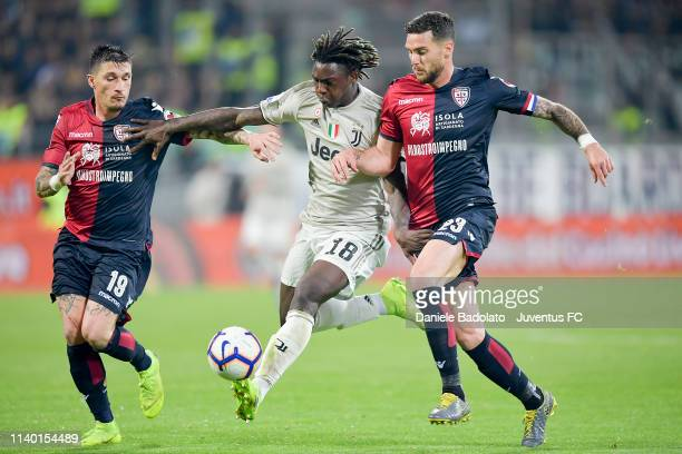 Cagliari players Fabio Pisacane and Luca Cappitelli with Juventus player Moise Kean during the Serie A match between Cagliari and Juventus at...