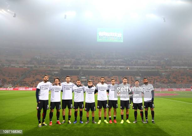 Cagliari players pose before the Serie A match between AC Milan and Cagliari at Stadio Giuseppe Meazza on February 10 2019 in Milan Italy