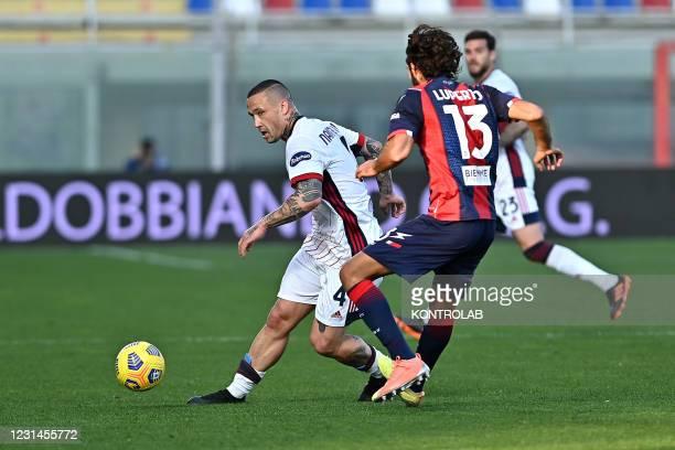 Cagliari's belgian midfielder Radja Nainggolan in action against Crotone's italian defender Sebastiano Luperto during the Italian Serie A football...
