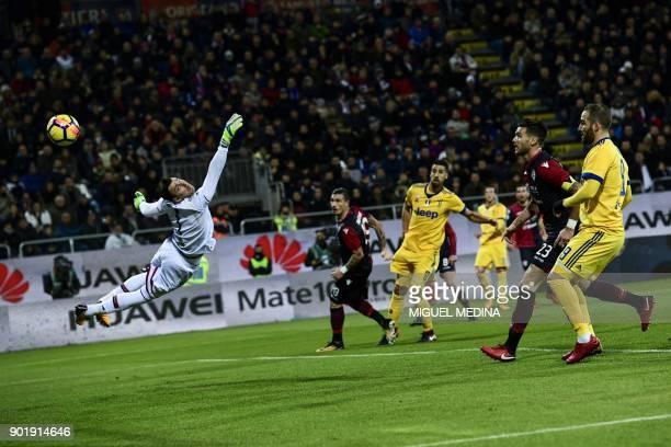 Cagliari's Brazilian goalkeeper Rafael de Andrade stretches to avoid a goal during the Italian Serie A football match between Cagliari Calcio and...