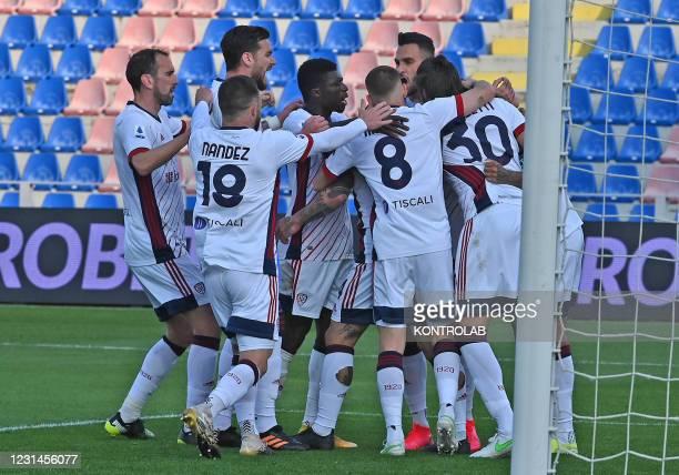 Cagliari's brazilian midfielder Joao Pedro celebrates with teammates after scoring the 2-0 goal during the Italian Serie A football match FC Crotone...