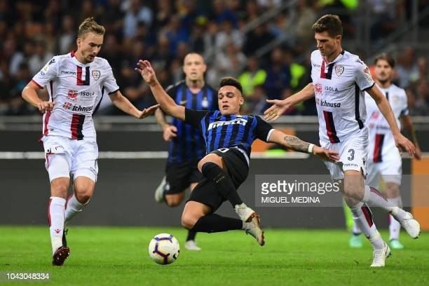 Cagliari's Croatian midfielder Filip Bradaric Inter Milan's Argentine forward Lautaro Martinez and Cagliari's defender Marco Andreolli go for the...