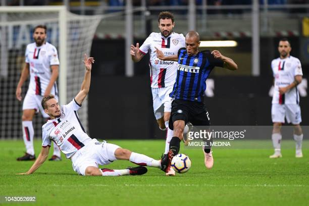 Cagliari's Croatian midfielder Filip Bradaric tackles Inter Milan's Brazilian defender Miranda during the Italian Serie A football match Inter Milan...