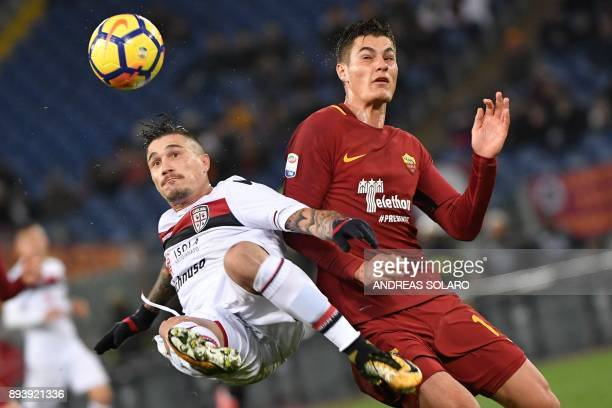 Cagliari's defender from Italy Fabio Pisacane fights for the ball with Roma's Czech striker Patrik Schick during the Italian Serie A football match...
