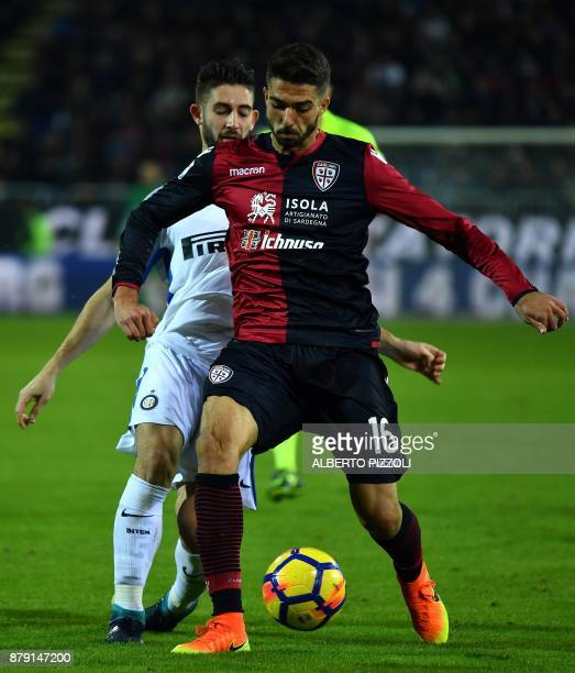Cagliari's defender Paolo Farago fights for the ball with Inter Milan's midfielder Roberto Gagliardini during the Italian Serie A football match...