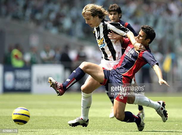 Cagliari's Francesco Pisano tackles Juventus's Pavel Nedved during the last Serie A football match of the season 29 May 2005 in Turin's Delle Alpi...