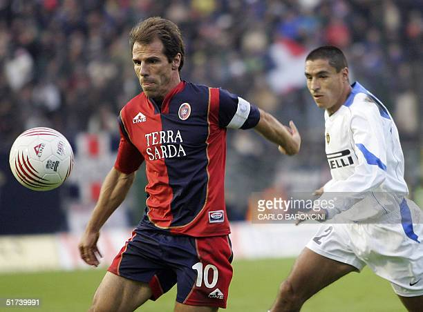 Cagliari's Gianfranco Zola runs with the ball followed by InterMilan's Ivan Cordoba during their Italian Serie A football match at Sant'Elia stadium...