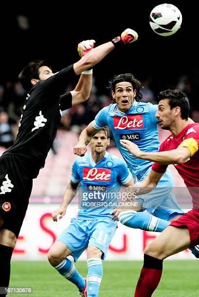 Cagliari's goalkeeper Michael Agazzi boxes the ball as SSC Napoli's forward Edinson Cavani tries to head it during the Italian Serie A football match...