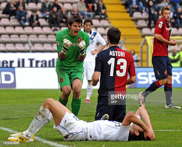 Cagliari's goalkeeper Michael Agazzi reacts after Davide Astori stopped Andrea Ranocchia's shot during the Italian Serie A football match between...