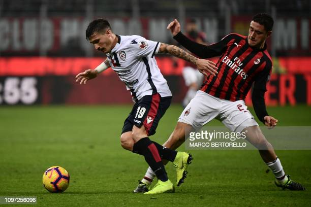 Cagliari's Italian defender Fabio Pisacane outruns AC Milan's Italian defender Davide Calabria during the Italian Serie A football match AC Milan vs...