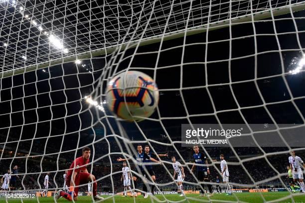 Cagliari's Italian goalkeeper Alessio Cragno fails to stop Inter's second goal during the Italian Serie A football match Inter Milan vs Cagliari on...