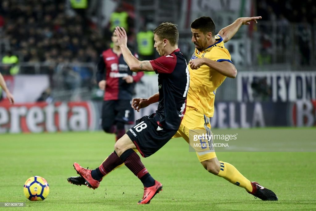 Cagliari's Italian midfielder Nicolo Barella vies with Juventus' Germain midfielder Sami Khedira during the Italian Serie A football match between Cagliari Calcio and Juventus at the Sardegna stadium in Cagliari, on the Sardinia mediterranean island on January 6, 2018. /