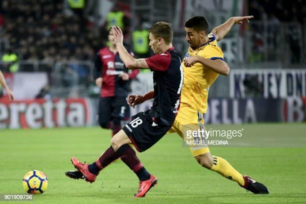 Cagliari's Italian midfielder Nicolo Barella vies with Juventus' Germain midfielder Sami Khedira during the Italian Serie A football match between...