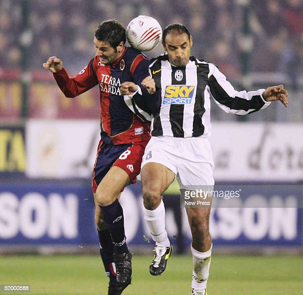 Cagliari's Massimo Gobbi contest the ball with Emerson of Juventus during the Serie A match between Cagliari and Juventus at Stadio San Elia January...