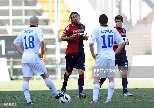 Cagliari's midfielder Daniele Conti argues with Inter Milan's Tommaso Rocchi after his team scored during the Italian Serie A football match between...