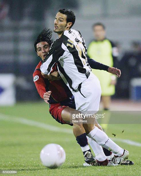 Caglirai's Mauro Esposito clashes with Gianluca Zambrotta of Juventus during the Serie A match between Cagliari and Juventus at Stadio San Elia...