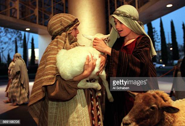 Glory.of.easter.1.0408.AS––GARDEN GROVE––Angie Zeiderman left, and Justin Womack play with a lamb before going onstage for the Glory of Easter...