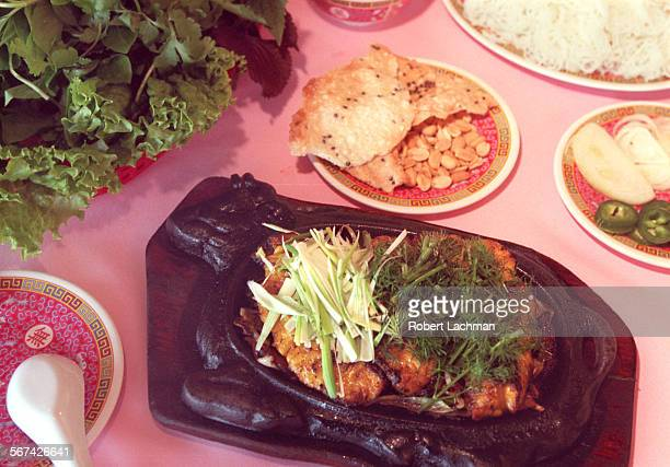 CAHaNoiFishRDL At the Ha Noi Restaurant in Garden Grove Cha Ca Thang Long Barbecued fish on a sizzling platter TIMES PHOTO BY ^^^