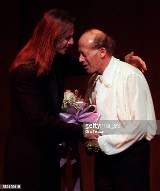 CAHelfgott10325GFPianist David Helfgott gets flowers and a hug from Scott Hicks director of the movie Shine after Helfgott performed at the Dorothy...