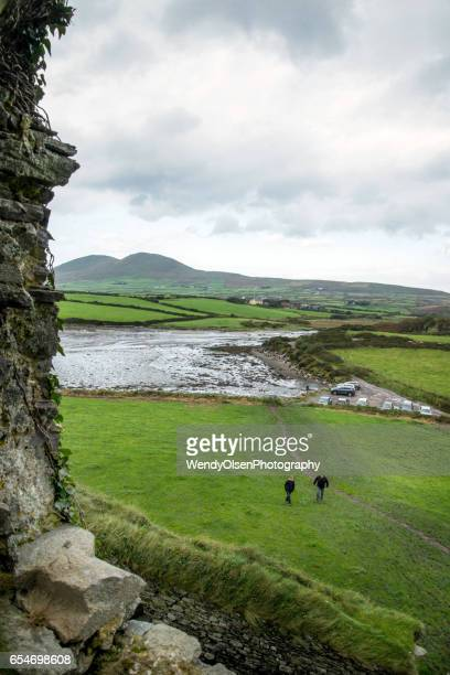 Cahersiveen, Kerry, Ireland. Ocotober 4, 2016. View of Ireland as taken through an old stone window. Two people can be seen walking towards the castle ruin .
