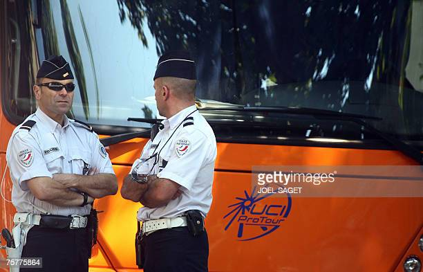 Policemen stand by a Dutch Rabobank bus reading the UCI Pro Tour logo before the start of the 18th stage of the 94th Tour de France cycling race...