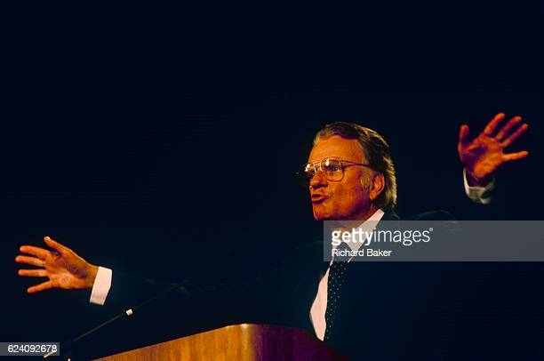 Cahrismatic American evangelist Billy Graham preaches with open hands to British Christians during Mission 89 a series of evangelical revival rallies...