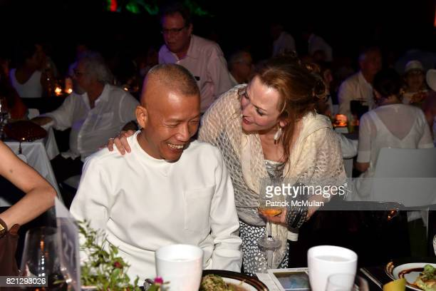 Cai GuoQiang and Alexandra Munroe attend Boom The Cosmic LongHouse Benefit at LongHouse Reserve on July 22 2017 in East Hampton New York