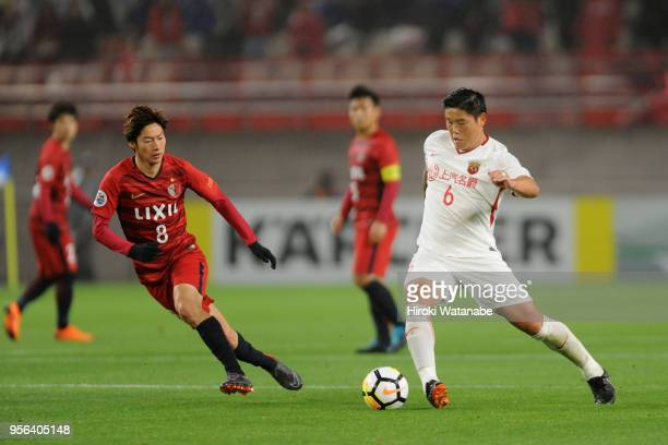 Cai Huikang of Shanghai SIPG takes on Shoma Doi of Kashima Antlers during the AFC Champions League Round of 16 first leg match between Kashima...
