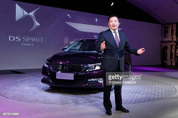 Cai Jianjun Vice President of Changan PSA a joint venture initiated by China Changan Automobile Group and PSA Peugeot Citroen speaks during the...