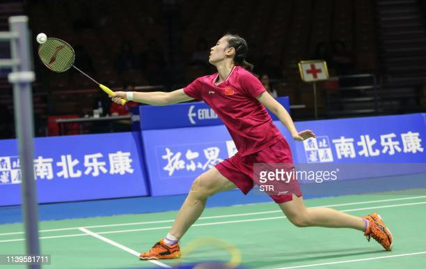Cai Yanyan of China hits a return against compatriot He Bingjiao during their women's singles semifinal match at the 2019 Badminton Asia...