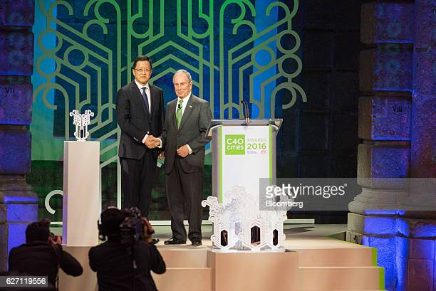 Cai Yu, member of the Development Reform Committe of Shenzhen, China, shakes hands with Michael Bloomberg, founder of Bloomberg LP and former mayor...