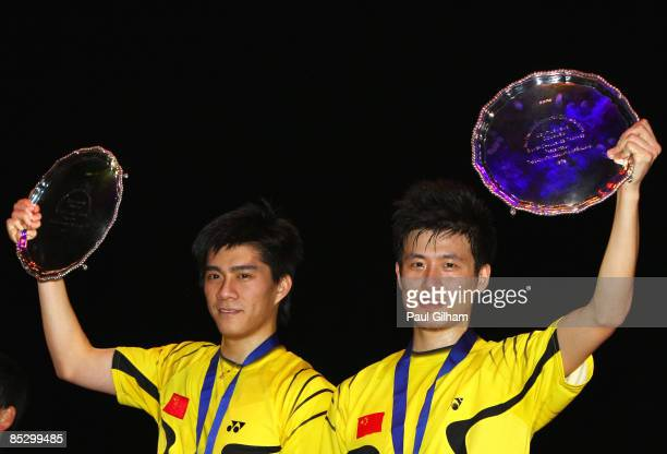 Cai Yun and Fu Haifeng of China celebrate winning the men's doubles final against Han Sang Hoon and Hwang Ji Man of Korea during the Yonex All...