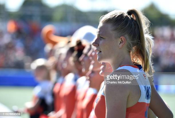 Caia van Maasakker of Netherlands stands with team mates as they sing their national anthem during the Women's FIH Field Hockey Pro League Final...