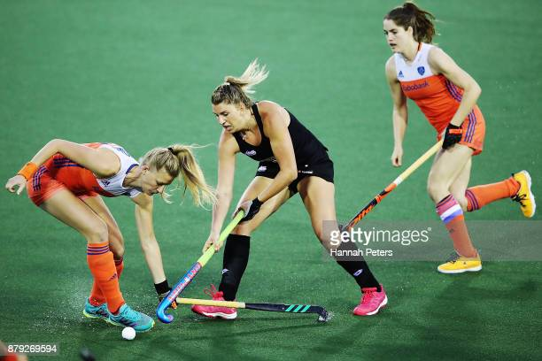 Caia van Maasakker of the Netherlands tackles Olivia Merry of New Zealand during the Hockey World League final between New Zealand and Netherlands at...