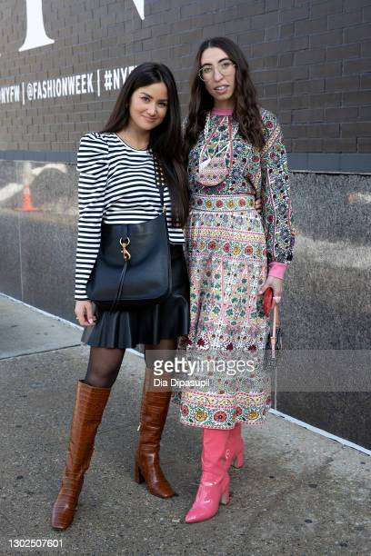 Caila Quinn and Caroline Vazzana pose outside New York Fashion Week at Spring Studios on February 16, 2021 in New York City.