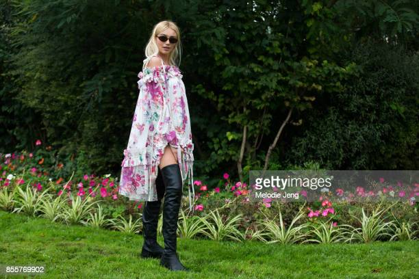 Cailin Russo wears a white and pink floral dress at Emanuel Ungaro on September 29 2017 in Paris France