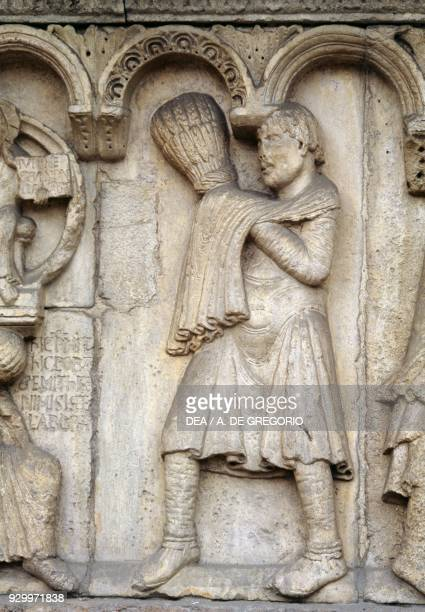Cain detail from Stories of Genesis by Wiligelmus marble basrelief facade of the Metropolitan Cathedral of Saint Mary of the Assumption and Saint...