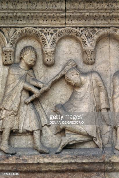Cain slaying Abel detail from Stories of Genesis by Wiligelmus marble basrelief facade of the Metropolitan Cathedral of Saint Mary of the Assumption...