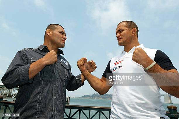 Cain Velasquez and Junior dos Santos square off during a UFC press tour event on July 29 2013 in San Francisco California